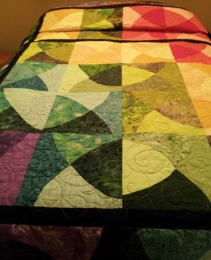 Jazzy Jewels bed quilt by Caroline H.